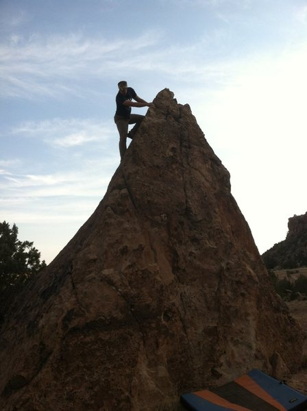 Zach on the downclimb of Triangle Boulder.