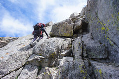 Rock Climbing Photo: Scrambling on Overhanging Tower