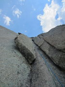 Rock Climbing Photo: John leading p3 (9+ var is the overhanging flake t...
