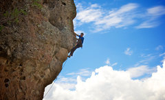 Rock Climbing Photo: Pulling up above the crux and into the easier terr...