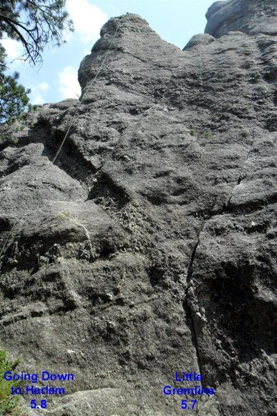 """""""Harlem, 5.8"""" is on the left, and """"Little Gremlins, 5.7"""" is on the right where the two vertical cracks are stacked on each other."""