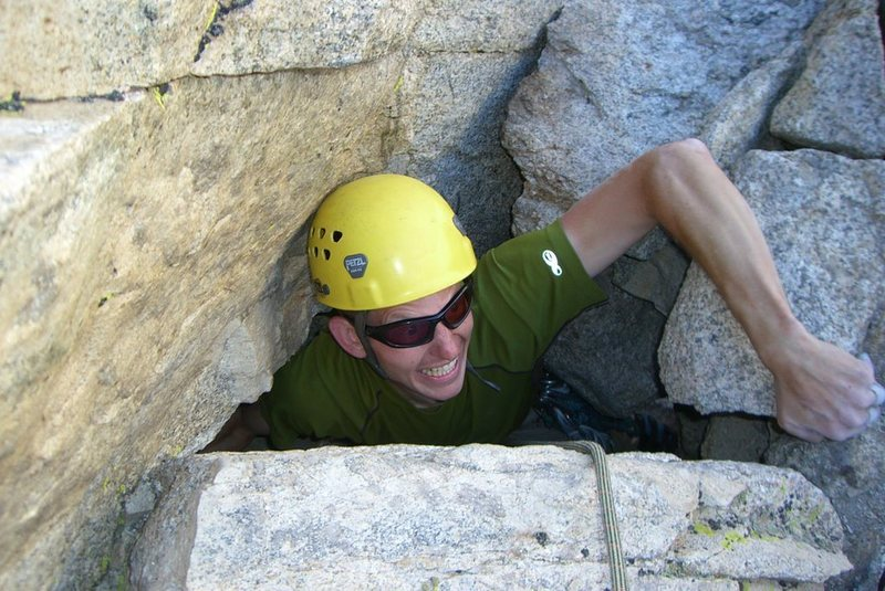 "At 6'5"" I struggled *hard* to get through the ""birth canal"" exit to the summit. September 2007."