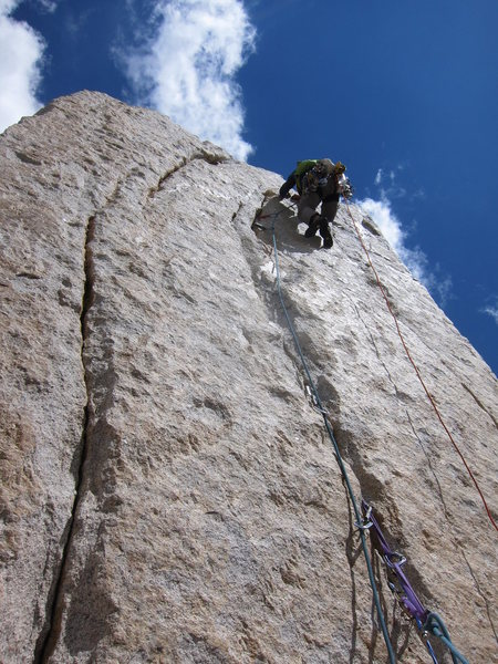 Casey post crux on the golden face of Pitch 5 of the Croft-Rands Left