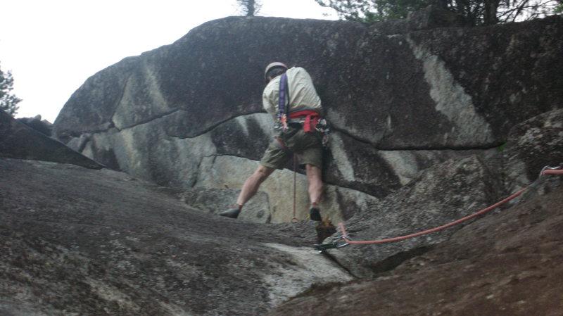 Jon Nelson climbing the first hard move