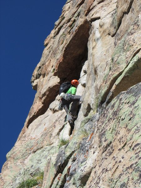 Moving up the dihedral to the roof of pitch three.