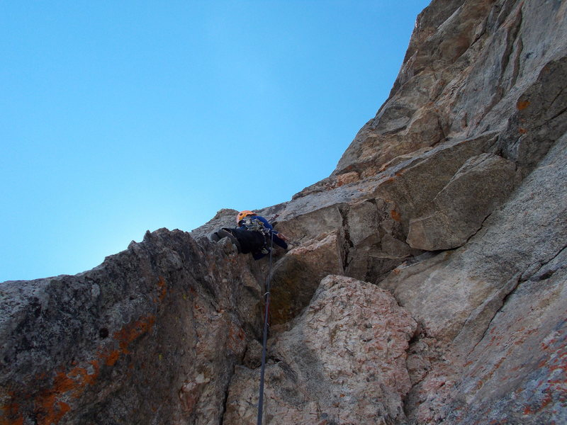 Starting into the crux of Phil-a-Guster, Tom Jensen climbing