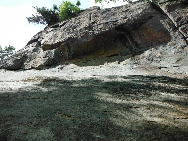 looking up the slab to the roof of Adirondack Rehab 5.10a<br> <br> Photo taken by Paul Roberts