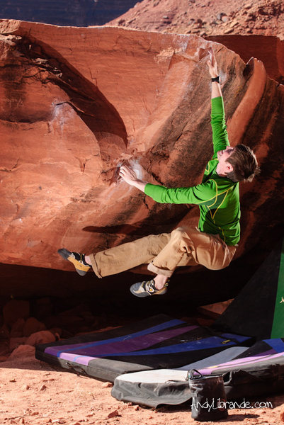 Chris barely missing the top of the reachy &quot;Dyno for Dollars&quot;<br> <br> Feb 2012<br> <br> http://andylibrande.com/news/2012/05/moab-bouldering-in-february/