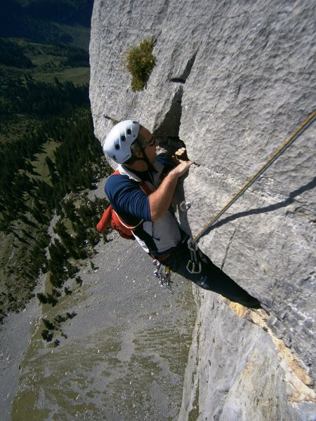 Pitch six, pulling over onto the belay ledge