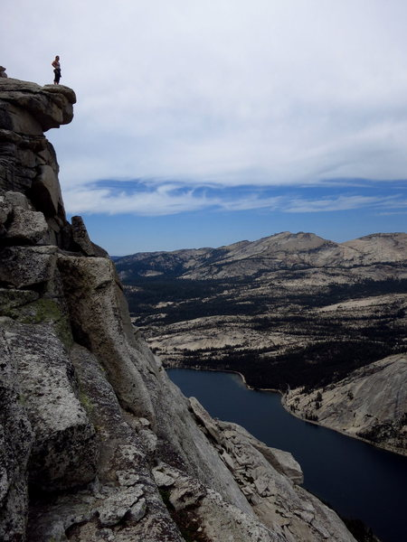 Christina scopes the view from the summit of Tenaya Peak on a cool cloudy summer day. 7/2012. <br> <br> Photo: Corey Gargano