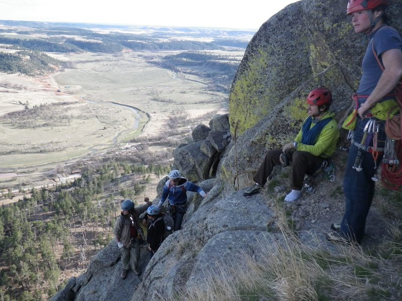 Here's a photo of Gil I took this year on top of Devil's Tower.  Gil is the one in the green sitting.  We're waiting to rap off.