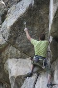 Rock Climbing Photo: Clipping the last and hardest clip before the fina...