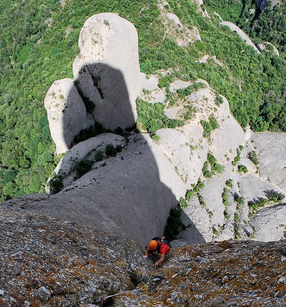 High on Cavall Bernat Marc follows the cracks making up the first part of the Puigmal (5.10c,A1 7 pitches)