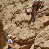 Me climbing at Holcomb, Chris on belay