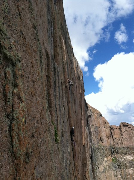 Adrian preparing to mantel onto the A4 Traverse on the Yellow Wall.  Tony belaying.  7/27/12 taken from D7 Variation.