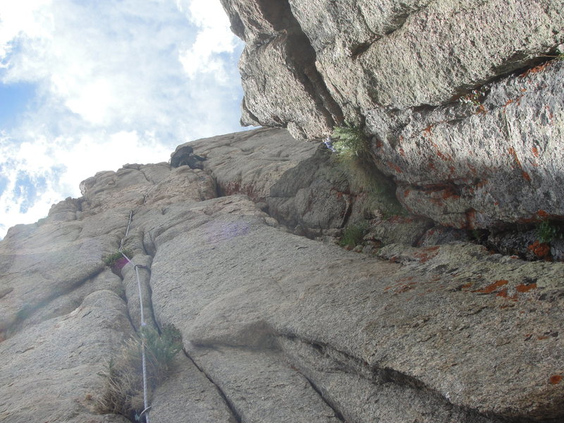 Taylor Roy high on P4.  Just past the pegmatite band and pulling into the chimney.
