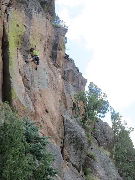 John Crawley moves through superb technical climbing before the crux of Free Radical. In this photo, John is linking Back to Nature with Free Radical.