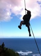 Rock Climbing Photo: Travis rappelling off a route at the Mokuleia Wall...