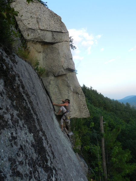 Jonathan Garlough on Layback Route. The chimney can be seen above.<br> <br> Photo by James Dickson