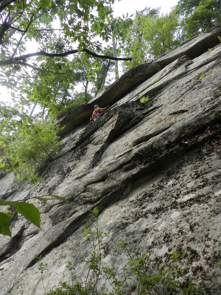 Loran Smith under the roof on his route Coyote Rain