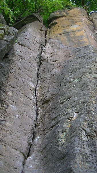 The route starts in the crack and ends on the yellowish face to its right.
