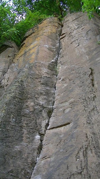 The route follows the crack all the way up with the bolts on the left.