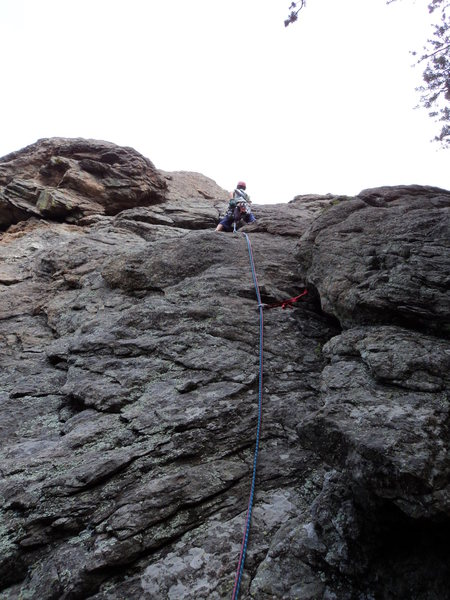 Deb moves into the crack below the right-facing dihedral.
