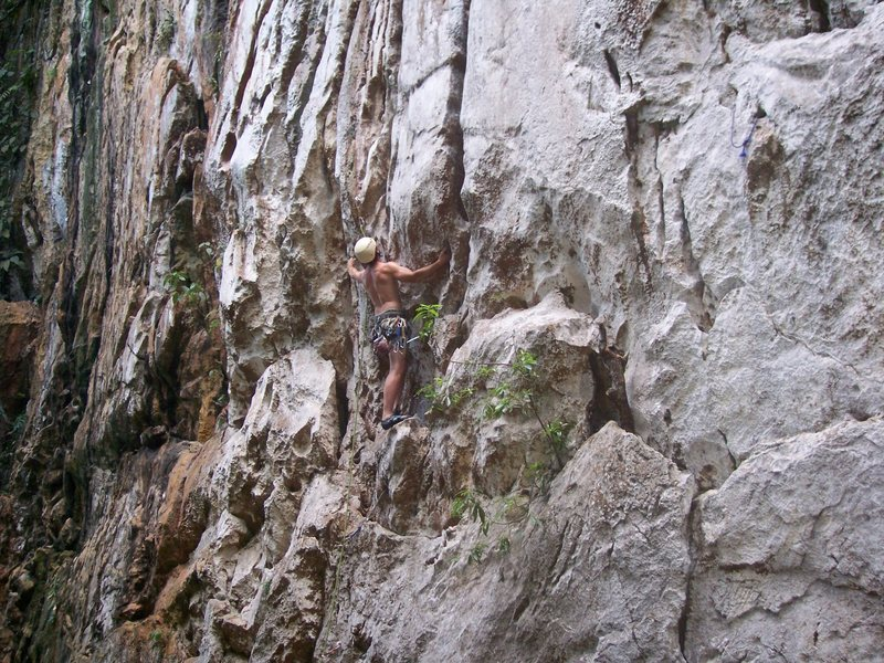 """Beginning of overhung pinnicle between the two cracks. Eric Coffman """"partner in climb"""". 5.10"""