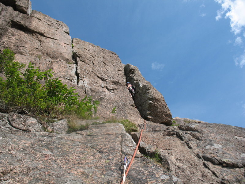 """Jenn is leading """"Off-Width Chimney"""". The top of """"Moraviana"""" is the crack to her left."""
