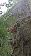Rock Climbing Photo: JJ Schlick setting up for the crux...