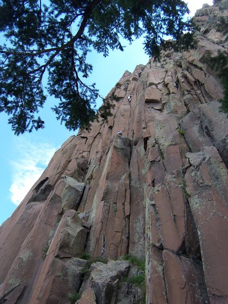 "This is the ""Unknown 5.10"" Manky posted.  You can see the belayer, Matt, at the top of the 60 foot initial pitch and me in the sweet hand crack above.  The shade of the nearby big fir tree which is the landmark is also apparent."