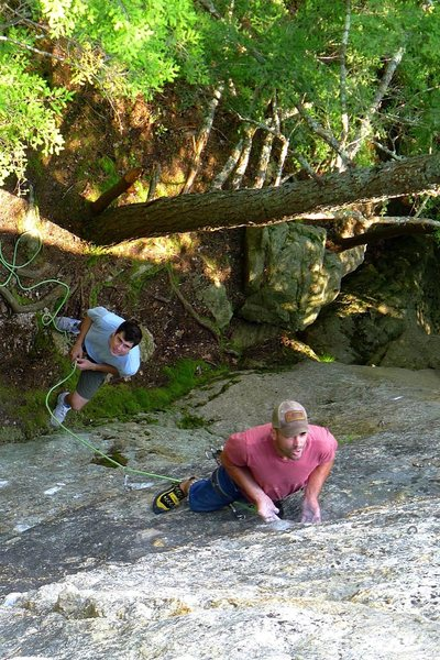 Will at the undercling rest, belayed by Pat Bagley.