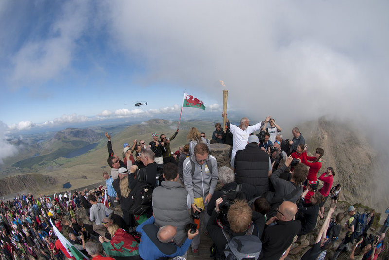 Chris Bonington on the summit of Snowdon with the Olympic torch