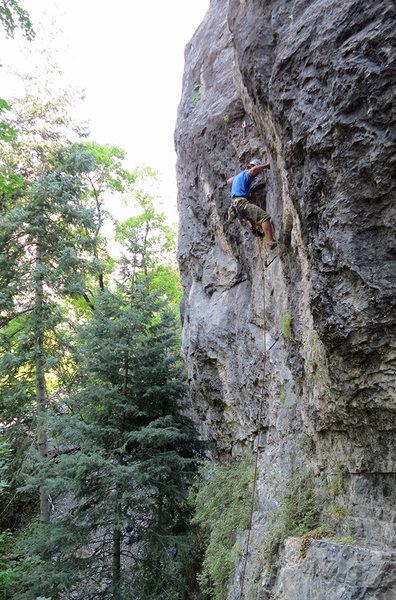 Jon Scoville climbing through the cruxy bit.