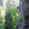 Jon Scoville, tackling the roof/arete to the left of the finishing slabby part.