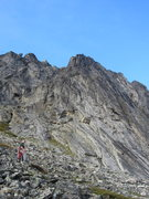 The western flank of the Main Wall. The Gash begins above and to the left of the climber.
