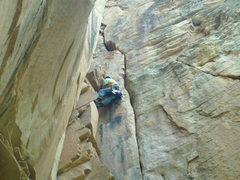 Rock Climbing Photo: Scott working the short OW section on FA.