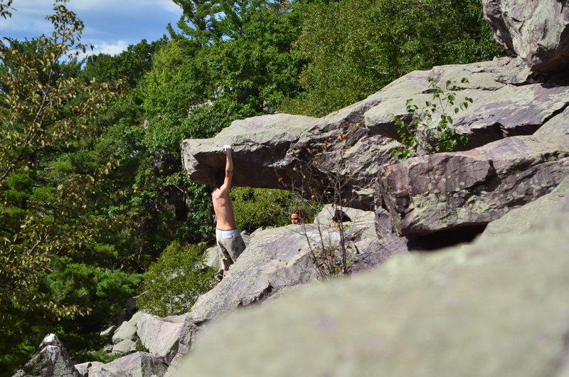 Rock Climbing Photo: Dobbe feeling some of the holds.  Starts on the ch...