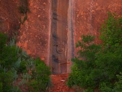 Rock Climbing Photo: Sun and moon figures carved into the sandstone (th...