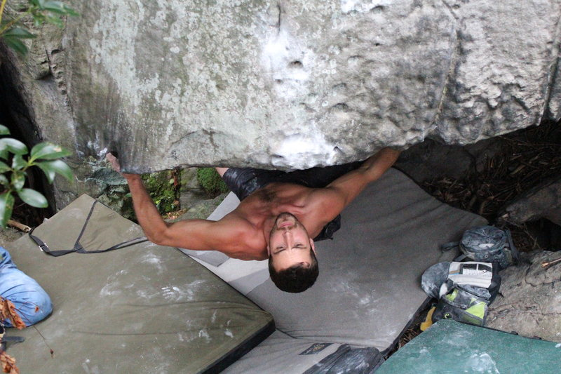 Rock Climbing Photo: Isaac eyeing up the blind throw on Mic Jagger V10.