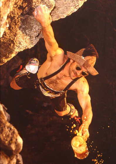 One of the most famous photos of Frankenjura history: Kurt Albert wearing traditional Bavarian clothing and carrying a Maß (1 Liter of beer) while free soloing Devil's Crack.