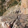 View down to the belay station at the start of the slick dihedral pitch.  Nice crack to finish.