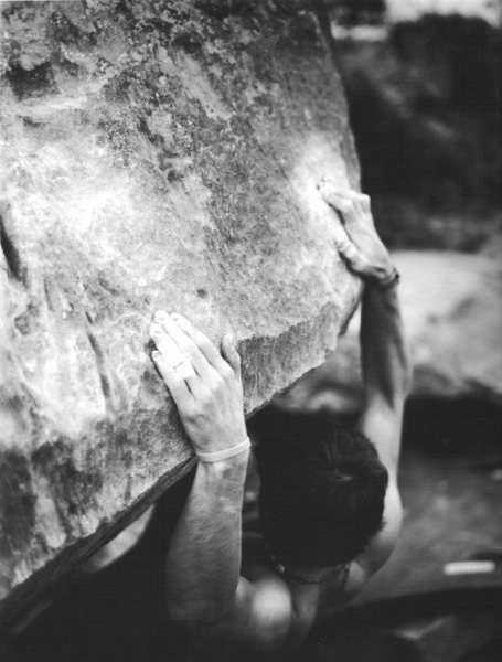 A friend's photo of the younger CK, bouldering.