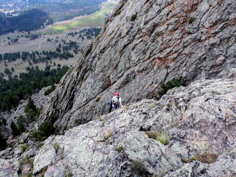Deb tops out.  It gives you a general sense of the line's location with the east face of the 2nd buttress in the background.