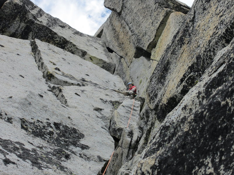D. Lucander on the outstanding final pitch corner of Prusik Peak S. Face