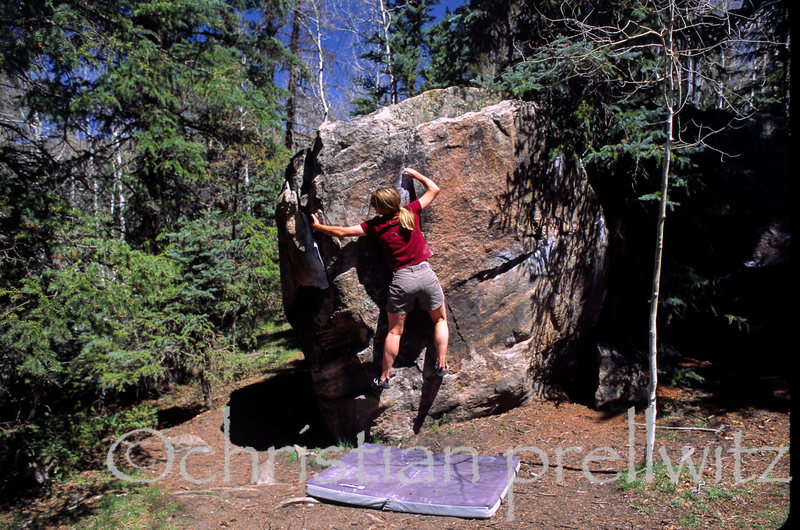 The late, great Christine Boskoff moving through the crux of 'Walking on Eggshells' (V1+)- Telluride, Colorado. <br> <br> Photo by Charlie Fowler.<br> <br> We miss you guys....