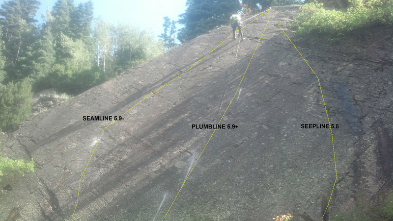 Cory raps from the top of the Slab of Despair.  The routes are listed.