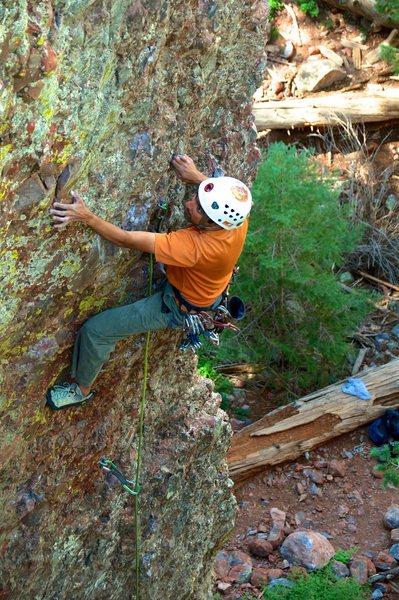 Reaching for a sidepull on Slacker Ken. August 2012.