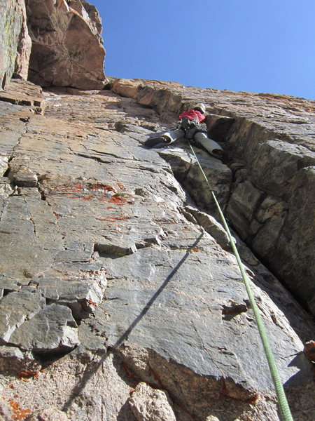 An unknown 5.10 variation on Flying Buttress. Brent Butler climbing. Mt. Meeker, RMNP, Colorado.