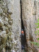 The slot/alcove. Stefani is bolting Rebar & Rakes. I've Got Blisters On My Fingers starts on the arete on the right